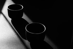 Two empty black cups