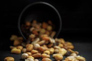 Mix of tasty nuts on dark table