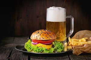 Hamburger with fries and beer