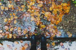 Black boots and autumn leaves