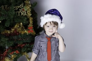 Cute boy near a Christmas tree