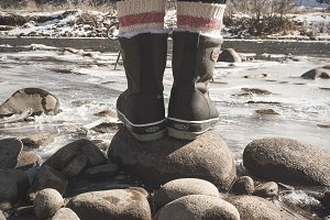 Boots on a Rock in Front of a River