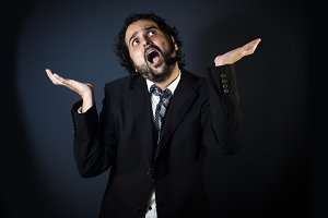 Man screaming on black background
