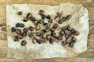 Roasted chestnuts on craft paper