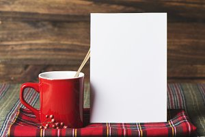 coffee cup and letter note, plaid bl