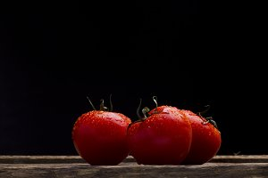 Red Tomato in spray of water