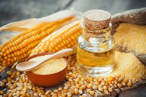 Corn oil bottle, groats and seeds