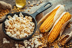 Popcorn in frying pan and corncobs