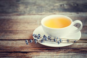 Tea cup and dry lavender flowers
