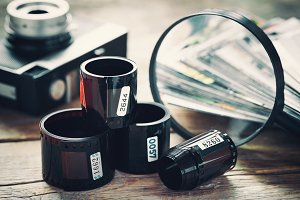 Photo film, camera, photos and loupe