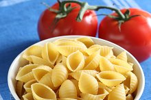Pasta inside  bowl with tomatoes