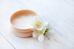 Pot of beauty cream with  blossom