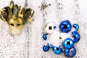 Snow, blue balls and golden mask