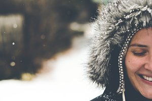 Woman in Snow Smiling Eyes closed