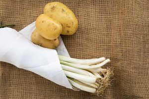 Potatoes and leeks with white napkin