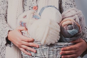 Woman with basket of balls yarn