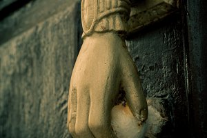 Gold Hand on Door Knob