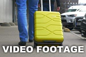 Man Rolling Yellow Trolley Bag