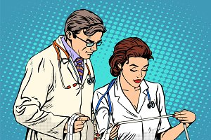 Doctor and nurse looking cardiogram