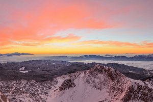 Vivid sunrise panorama in mountains