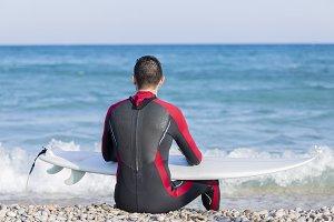 male surfer resting
