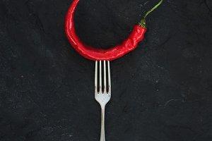 Red hot chili pepper on vintage fork