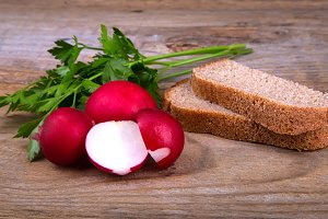 Fresh red radish parsley and bread