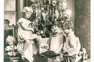 Happy kids with christmas tree