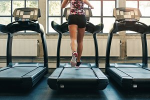 Fitness woman running on treadmill