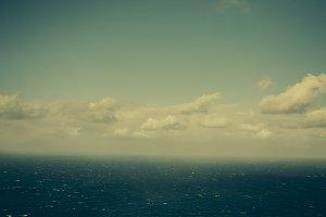 Retro clouds over the sea