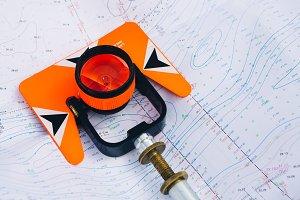 orange theodolite prism  lies
