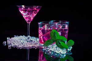 wine glass and two glasses with pink
