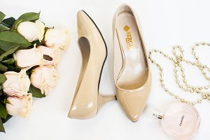 Beige shoes and cream roses image