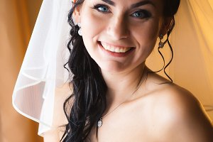 beautiful young happy bride standing