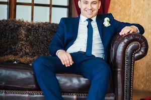 elegance groom is posing