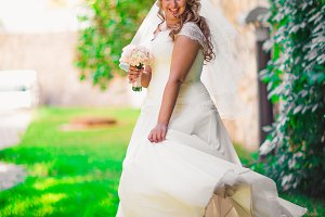 Stylish beautiful happy bride