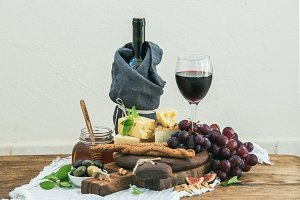Glass of red wine and cheese board