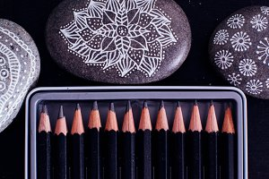 Pencils and painted stones