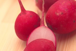 fresh radishes over wood table H10  2.jpg