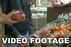 Customers choosing tomatoes