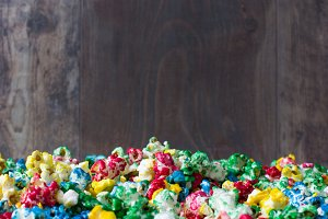 Sweet popcorn and wood background