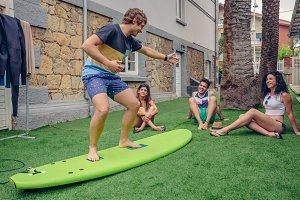 People having fun in a surf class