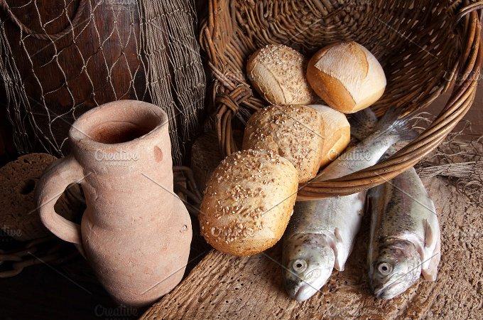 Wine jug with bread and fish....jpg - Food & Drink