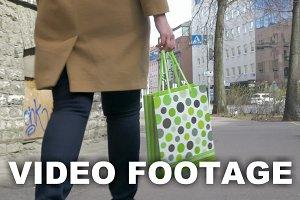 Girl with shopping bag walking