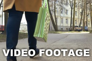 Woman Walking with Green Shopping
