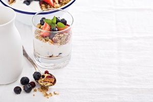 Granola with fresh berries in glass