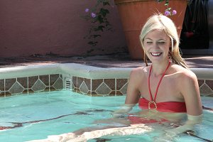 Blond girl in the pool