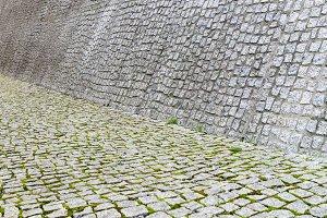 Cobblestone pavement and wall