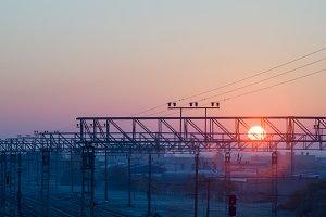 Sun rising over railway terminal