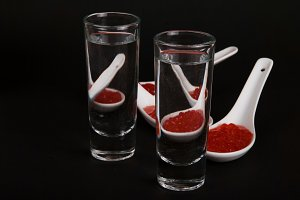 Red  caviar in white ceramic spoons.